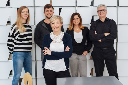 Photo of small business team with woman