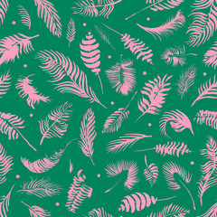 Palm branches on the color background. Exotic pattern. Hand drawn watercolor tropical seamless pattern with the botanical silhouettes of palm leaves. Minimal design of app background, cloth print.