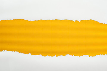 ripped white textured paper with copy space on yellow striped background