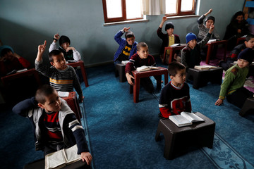 The Wider Image: Without papers, Uighurs fear for their future in Turkey