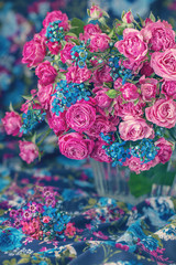 Close-up floral composition with a pink roses on a colorful background..Many beautiful fresh pink roses on a table.