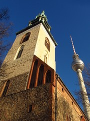 Berlin Germany St. Mary's Church and TV Tower with blue sky