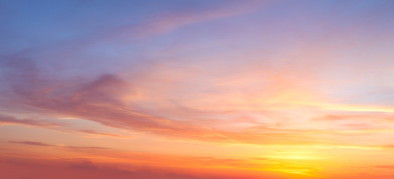 Majestic real sunrise sundown sky background with gentle colorful clouds