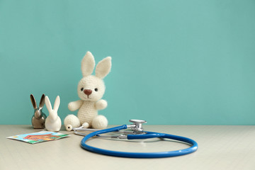 Toy bunnies with stethoscope on table