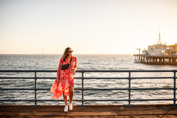 USA, California, Santa Monica, smiling woman standing on the pier