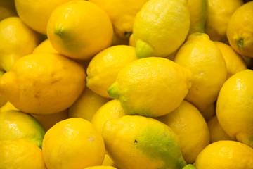 Fototapeta  Group of fresh lemons for sale in the market
