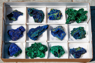 Close up of azurite and malachite mineral specimens in a box