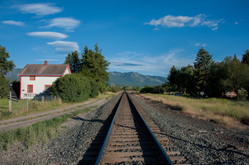 View of railway track passing through grassy landscape