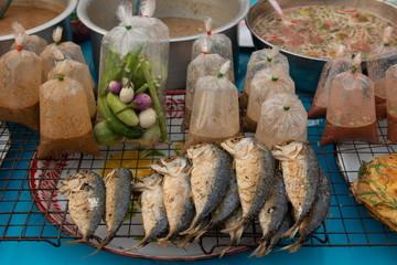 Obraz fried mackerel fish and kapi spicy sauce at market , thai famous food . - fototapety do salonu