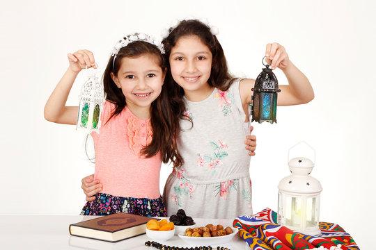 Happy Family in Ramadan - Cute girls playing with Ramadan lanterns - celebrating the holy month of Ramadan