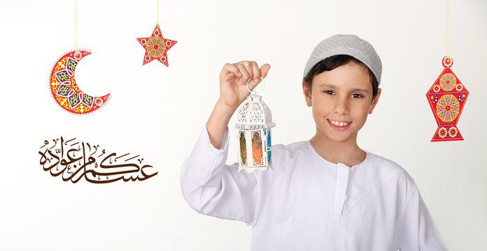 Greeting Card : Ramadan Mubarak -  Arabic Translation : I wish you live and celebrate next Ramadan - Happy young Muslim kid celebrating Ramadan