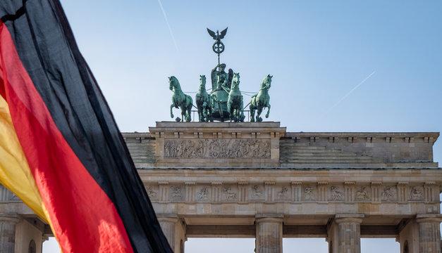 Berlin Brandenburg Gate with german flag