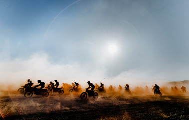 Group of motocross motorcycles coming out in the race
