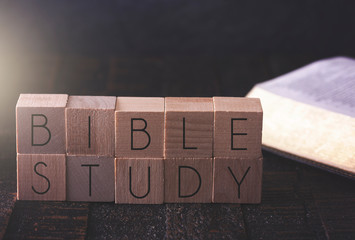 Bible Study Spelled in Block Letters on a \ Table with a Bible