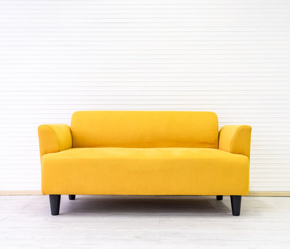 Yellow modern comfortable sofa in living room apartment with white wall.Furniture decorate design at home .