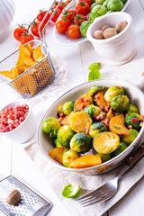Foto op Canvas Assortiment Roasted Brussels sprouts with honey and sesame from the oven