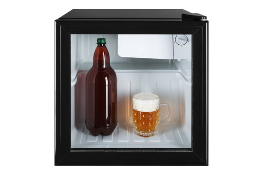 small fridge bar, inside the bottle and glass full of beer with foam, the concept of summer and cooling
