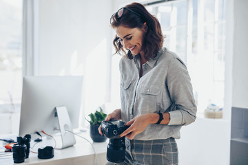 Female photographer working in her office
