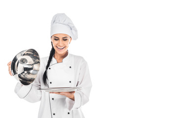 Chef in hat holding tray with cloche isolated on white