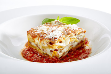Lasagna with Tomato Sauce Isolated on White Background