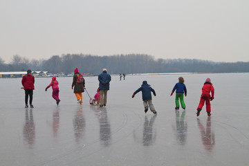 Kids, teenagers and grown-up enjoying ice scating in Amsterdam the Netherlands.