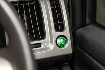 Сlose-up of the car  modern interior of the power save  economy button. ..