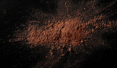 Cocoa powder isolated on black background and texture