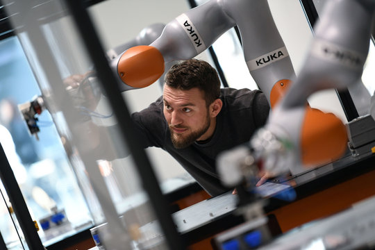 Tobias Jakob, an employee of German manufacturer of industrial robots and automation solutions KUKA