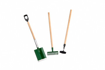Small gardening rake, hoe and shovel isolated on white background