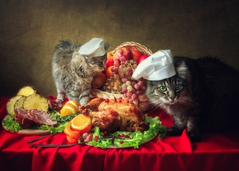 Still life with Thanksgiving table and curious cats