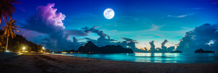 Colorful blue sky with cloud and bright full moon on seascape to night