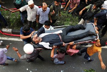 A person is being rescued as fire broke out at a multi-storey commercial building in Dhaka
