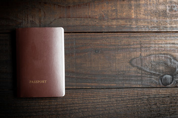 passport on wooden table background.