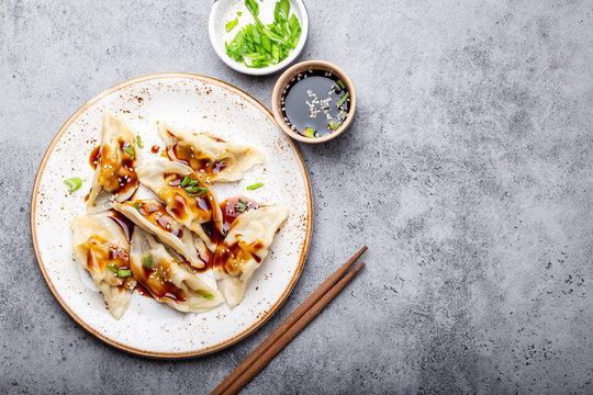 Asian dumplings on white plate