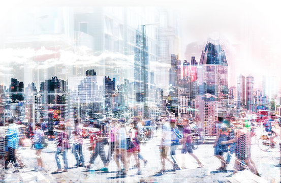 Crowd of anonymous people walking on busy city street - abstract city life concept