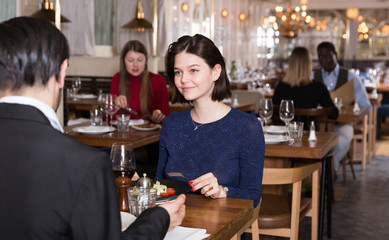 Woman with male colleague in restaurant