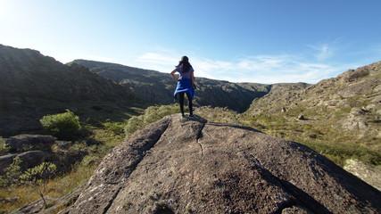 A hiker at Cerro Blanco reserve, near Tanti and Los Gigantes in the Altas Cumbres region, Cordoba, Argentina.