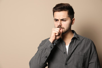 Printed kitchen splashbacks Artist KB Handsome young man coughing against color background. Space for text