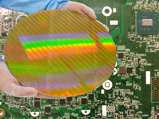 Wall Mural - holding a Silicon wafers inspection,detail of a silicon wafers reflection light or Reflection,  on pcb background,