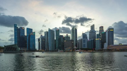 Wall Mural - Singapore city skyline with landmark buildings day to night time lapse in Singapore