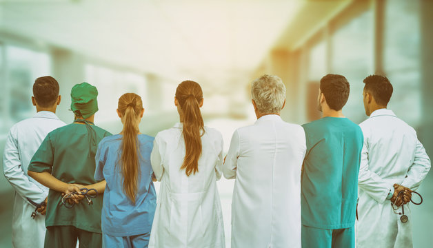 Healthcare profession teamwork and doctor service concept - International medical staff group of doctors, nurses and surgeon specialist standing with stethoscopes in the hospital.