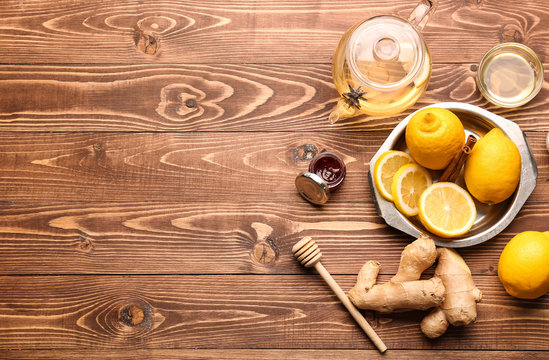 Tasty tea with lemon, ginger and honey on wooden table