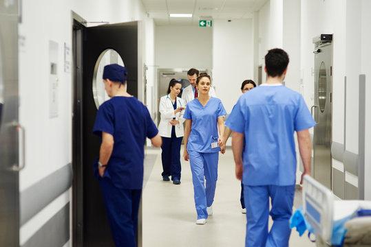 Doctors walking through corridor in hospital