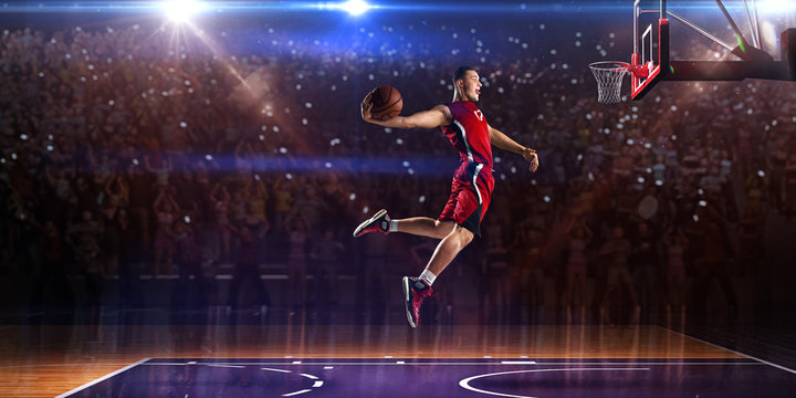 Basketball player in jump. around Arena with blue light spot