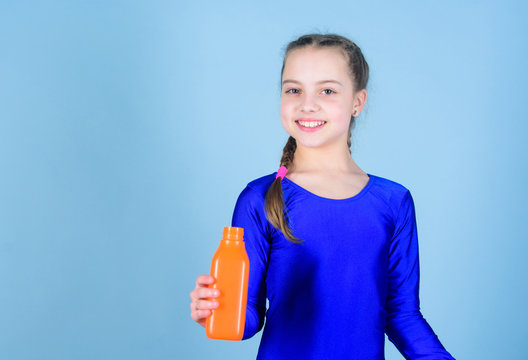 Quench thirst. Child feel thirst after sport training. Kid cute girl gymnast sports leotard hold bottle for drink. Water balance and hard gym training. Drink more water. Keep water bottle with you
