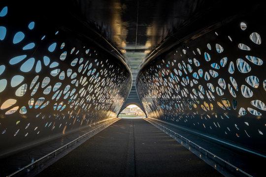 ANTWERP, BELGIUM - 02 15 2019: Parkbrug tunnel bridge - Interior of Park Bridge, a pedestrian and cyclist bridge that connects Park Spoor Noord over the Noorderplaats with Het Eilandje