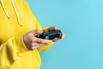 Young woman holding modern joystick in her hands