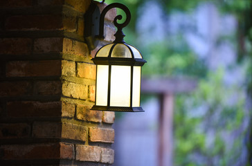 Vintage lantern wall brick decorate home and lamp garden background