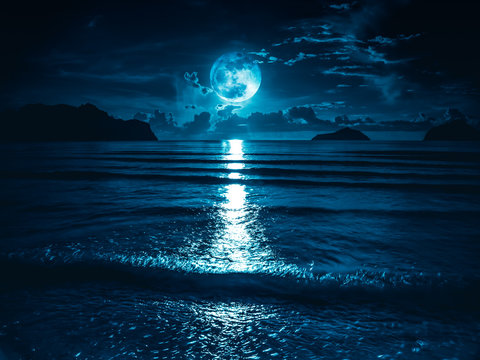 Super moon. Colorful sky with bright full moon over seascape.