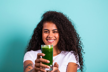 Healthy and Fitness concept - Beautiful American African lady in fitness cloth drinking healthy...